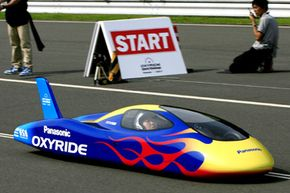 Driver Takashi Sudo steers the Oxyride racer powered only by 192 AA Oxyride dry batteries, during its run for a world record, at a test course near Mito, Ibaraki prefecture, north of Tokyo, on Aug. 4, 2007.