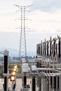 """The place where electricity converts from """"transmission"""" to """"distribution"""" occurs is in a power substation."""