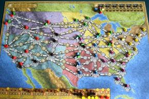 """The colorful map that comprises the """"Power Grid"""" game board depicts the U.S. and its major cities. The other side of the board represents Germany."""