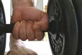 There's a risk of damaging property or crushing fingers and toes with barbells. A Powerbag doesn't present that risk.