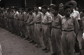 """This 1954 photo shows the first group of prisoners taken in Guatemala in the battle for Chiquimula by anti-Communist liberation forces. The impetus for this """"revolution"""" came in large part from United Fruit Company."""
