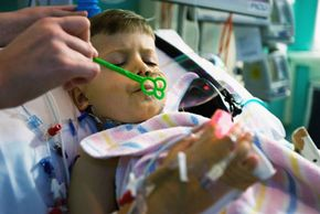 Studies have investigated whether intercessory prayer helps heal people recovering from illness, like this boy in an intensive care unit in Sydney, Australia.