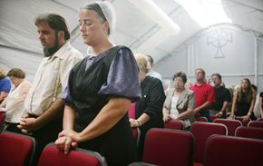 The Amish -- like this couple who attended the funeral of a man whose house they rebuilt after it was destroyed by Hurricane Katrina -- are often portrayed as models of piety in America. Is science capable of proving or disproving the effectiveness of their religious beliefs?