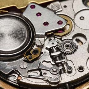 This isn't a Precisionist, but here you can see the inner workings of a quartz watch. The purplish bits are artificial ruby bearings, which create less friction and are longer lasting than metal bearings.
