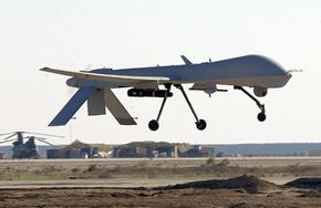 A Predator MQ-1 comes in for a landing after firing one of its Hellfire Missiles.