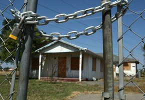 An abandoned home sits beyond a locked gate in Stockton, Calif. According to RealtyTrac Inc., Stockton had the highest foreclosure rate of large metropolitan areas in the third quarter of 2007, with one of every 31 homes in foreclosure.