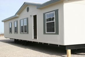 This manufactured home was built on a steel frame and will eventually sit on a permanent foundation.