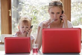 Like mother, like daughter -- should she get a cell phone like yours? See more parenting pictures.