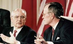 Pres. George H.W. Bush signs a nuclear nonproliferation treaty with Soviet President Mikhail Gorbachev in 1990.