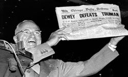 """President Harry Truman holds up the Chicago Daily Tribune headline trumpeting his """"defeat"""" in the 1948 presidential election."""