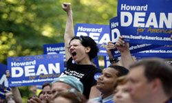 """A supporter for Democratic presidential candidate Howard Dean cheers for him in Falls Church, Va., during the first stop of his """"Sleepless Summer Tour"""" in 2003."""