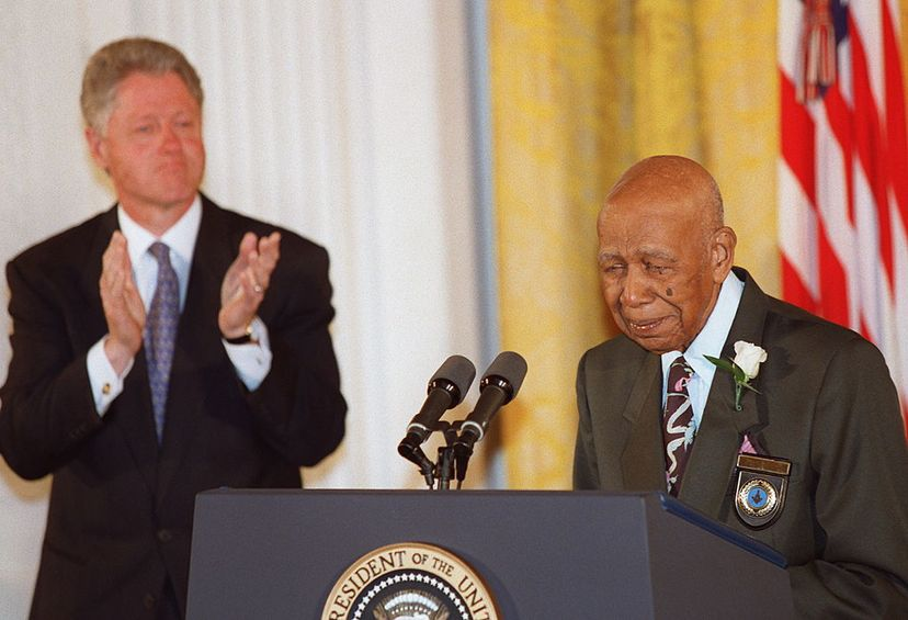 Ninety-four-year-old Herman Shaw (R) speaks as U.S. President Bill Clinton looks on during White House ceremonies in 1997, where Clinton apologized to the survivors and families of the Tuskegee Syphilis Study. Shaw was one of the study's subjects. PAUL J. RICHARDS / AFP/Getty Images