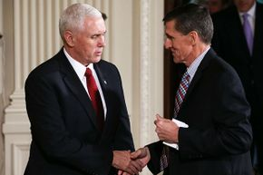 Vice President Mike Pence (L) shakes hands with National Security Adviser Michael Flynn on Feb. 10, 2017. By Feb. 14, Flynn had resigned after some undisclosed conversations with Russia's ambassador to the U.S. came to light.