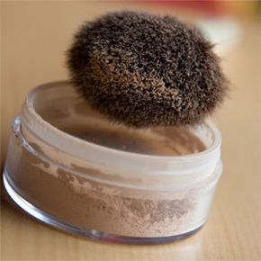Loose powder of the mineral makeup variety. Someone wisely traded the puff that came with it for a brush. Good move.
