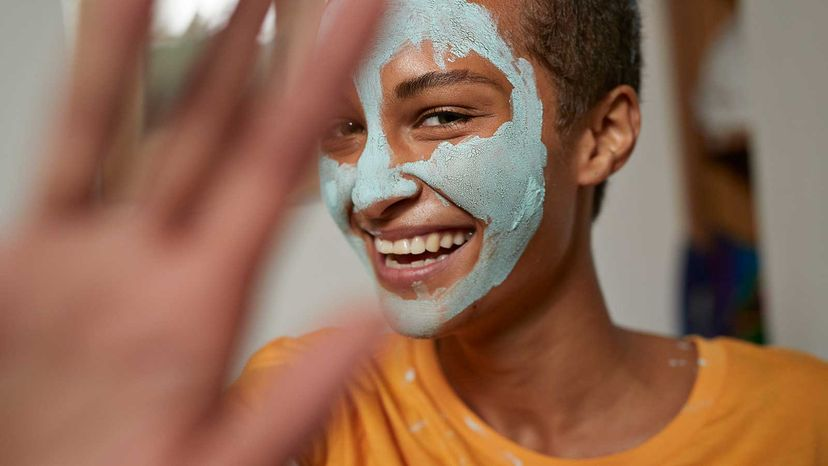 cute girl with facial mask