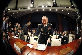 National Security Agency (NSA) Director U.S. Army Gen. Keith Alexander takes his seat to testify at the U.S. Capitol before a U.S. House Permanent Select Committee on Intelligence hearing on NSA surveillance programs on June 18, 2013.