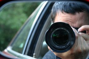 Surveillance often involves skill with a camera and long hours in the car.