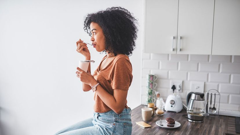 girl eating yogurst