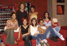 Contestants in the Coca-Cola room, on the Coca-Cola couch