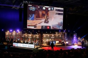 """An audience watches competitors playing """"Call of Duty Back Ops 3"""" during the 2016 Electronic Sports World Cup in Paris. The event draws the world's best video game teams."""
