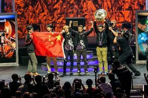 Members of Newbee pose onstage after their win at the 2014 International Dota 2 Championships.