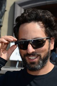 Google co-founder Sergey Brin uses a button on top of his Glass to take a picture at the Sun Valley Conference in 2012. Though Brin had to layer his Glass with standard sunglasses at the time, Google announced several Glass-compatible frames in early 2014.