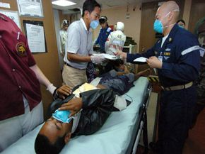 Victims of the 2004 tsunami in Banda Aceh, Indonesia are treated by Project HOPE workers at sea in the Indian Ocean.