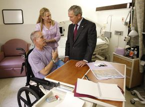 Former President George W. Bush visits Army Brigadier General William Fox, Jr. at Walter Reed Army Medical Center in Washington, D.C. General Fox, the CEO of Project HOPE, was injured while building a cancer facility for children in Basra, Iraq.