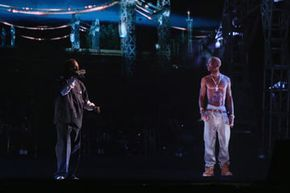 Snoop Dogg shares the stage with deceased rapper Tupac Shakur at the 2012 Coachella Valley Music & Arts Festival.
