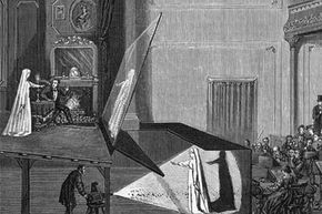 """This illustration, published in """"The World of Wonders"""" circa 1865, shows how the Pepper's Ghost illusion was employed in a theatrical performance using a projection reflected off of a large sheet of glass."""