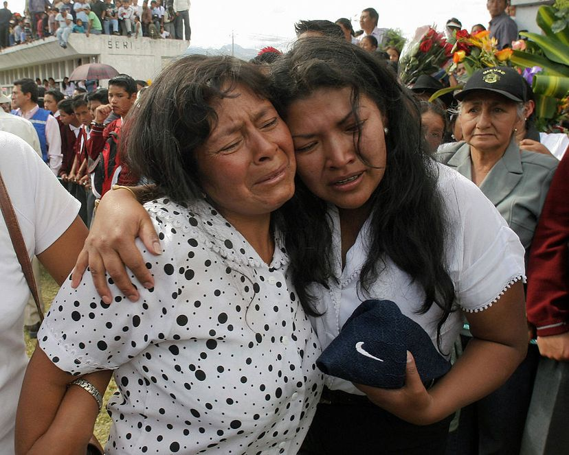 Two women mourn for their beloved during the funeral for people killed in a bus accident in Quito, Ecuador, in 2006. In 2002, Pedro Alonso Lopez received 14 years in prison in Ecuador for killing hundreds of people, mostly young girls. RODRIGO BUENDIA/AFP/Getty Images