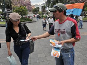 A man distributes leaflets of propaganda in Quito, Ecuador, to promote a constitutional referendum that will allow Pres. Rafael Correa to be re-elected.