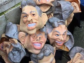 """Rubber Tony Blair masks are discarded in London after being worn to promote the TV show """"The Trial of Tony Blair."""" These masks' exaggerated features are clearly a caricature of the former prime minister."""