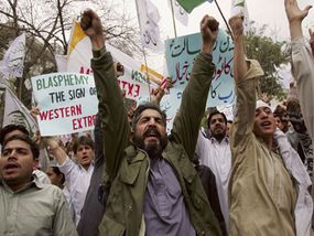 Supporters of the Islamic party Jamiat Ulema-i-Islam protest the depiction of Mohammed in political cartoons in 2006.