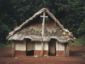 A church stands in an abandoned village in the Congo, a testament to mission work in Africa.