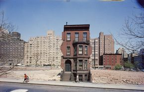 Even vacant lots, like the ones surrounding this brownstone in New York City, are assessed by property tax assessors.