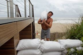 You can try to protect your home from storm surge with sandbags, like homeowner Marc Murphy (seen here) did in preparation for Hurricane Irene in August, 2011.