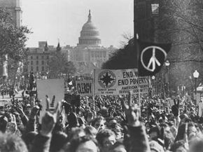 With the U.S. Capitol in the background, demonstrators march along Pennsylvania Avenue in an anti-Vietnam War protest in Washington, on Moratorium Day, Nov. 15, 1969.