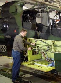 An engineer works on vehicles inside one of the two PIF bays.