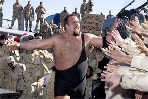 WWE RAW Superstar The Big Show greets soldiers in Afghanistan as he walks to the ring. The Big Show has gone from heel to face and back again many times during his 10-year wrestling career.