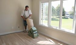 Refinishing hardwood floors can be back-breaking work, and there's such a small margin of error -- you run a risk of ruining your floors.