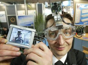 Stanislavs Bardins of Munich's Ludwig-Maximilians-University demonstrates the prototype of a video camera controlled by the eyes in Hanover, Germany. The camera could be used in application fields of psychology and market research.