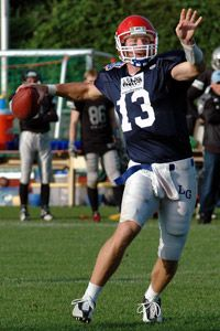 This quarterback, caught in mid-throw, is hoping for a completion.