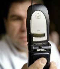 A Nextel customer looks over a Motorola telephone.