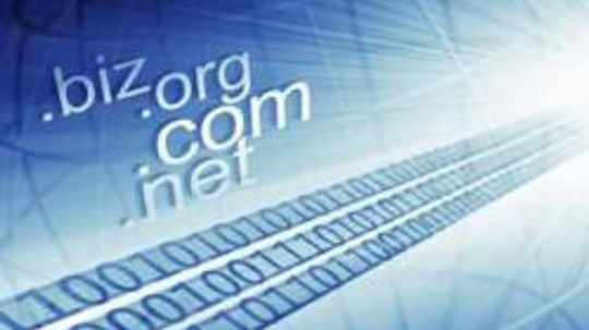 What are the standard top-level domain names and who controls them?