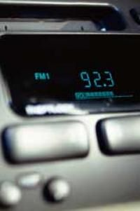 A car radio displays an FM station. Do you know why it ends in an odd number?