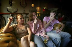 If the woman on the left quit smoking, both gentlemen with her are more likely to follow suit. But then they'd be forced to talk to each other.