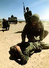 U.S. Army security police practice taking a prisoner.