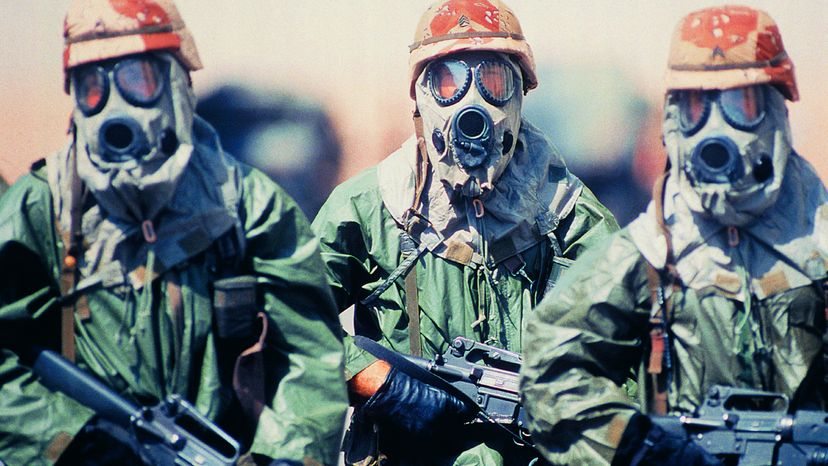 War Soldiers with Guns and Gas Masks