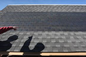 Solar panels attached to roof shingles create energy while being tested at the National Renewable Energy Laboratory (NREL) in Golden, Colo.